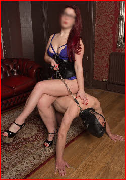 Manchester domme Mistress Rhianne uses slave as human furniture