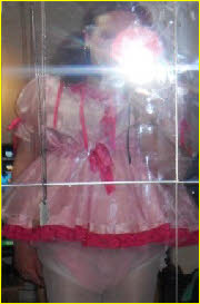 Scottish sissy Cassie in frilly pink little girl dress
